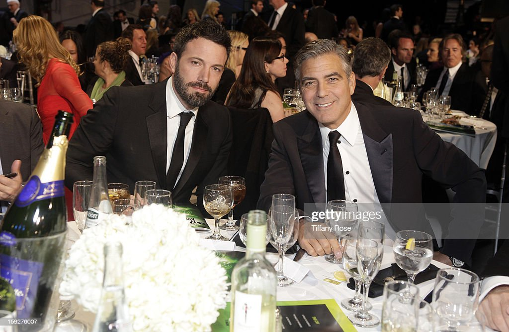 Director <a gi-track='captionPersonalityLinkClicked' href=/galleries/search?phrase=Ben+Affleck&family=editorial&specificpeople=201856 ng-click='$event.stopPropagation()'>Ben Affleck</a> and producer Geroge Clooney attend the Critics' Choice Movie Awards 2013 with Champagne Nicolas Feuillatte at Barkar Hangar on January 10, 2013 in Santa Monica, California.