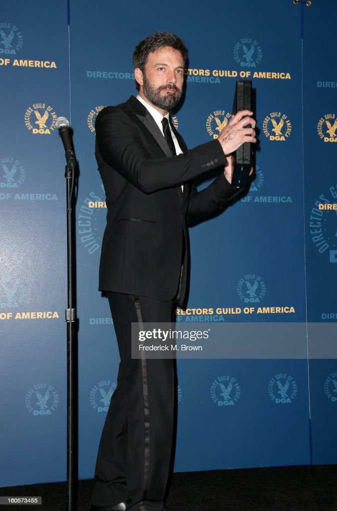 """Director <a gi-track='captionPersonalityLinkClicked' href=/galleries/search?phrase=Ben+Affleck&family=editorial&specificpeople=201856 ng-click='$event.stopPropagation()'>Ben Affleck</a>, winner of the Outstanding Directorial Achievement in Feature Film for 2012 award for """"Argo,"""" poses in the press room during the 65th Annual Directors Guild Of America Awards at Ray Dolby Ballroom at Hollywood & Highland on February 2, 2013 in Los Angeles, California."""