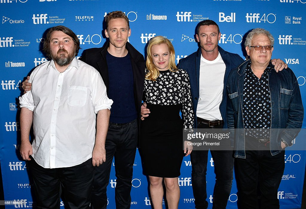 Director <a gi-track='captionPersonalityLinkClicked' href=/galleries/search?phrase=Ben+Wheatley&family=editorial&specificpeople=7352929 ng-click='$event.stopPropagation()'>Ben Wheatley</a>, actors <a gi-track='captionPersonalityLinkClicked' href=/galleries/search?phrase=Tom+Hiddleston&family=editorial&specificpeople=4686407 ng-click='$event.stopPropagation()'>Tom Hiddleston</a>, <a gi-track='captionPersonalityLinkClicked' href=/galleries/search?phrase=Elisabeth+Moss&family=editorial&specificpeople=3079265 ng-click='$event.stopPropagation()'>Elisabeth Moss</a>, <a gi-track='captionPersonalityLinkClicked' href=/galleries/search?phrase=Luke+Evans+-+Actor&family=editorial&specificpeople=7174812 ng-click='$event.stopPropagation()'>Luke Evans</a> and producer <a gi-track='captionPersonalityLinkClicked' href=/galleries/search?phrase=Jeremy+Thomas+-+Film+Producer&family=editorial&specificpeople=629756 ng-click='$event.stopPropagation()'>Jeremy Thomas</a> attend the 'High-Rise' press conference at the 2015 Toronto International Film Festival at TIFF Bell Lightbox on September 14, 2015 in Toronto, Canada.