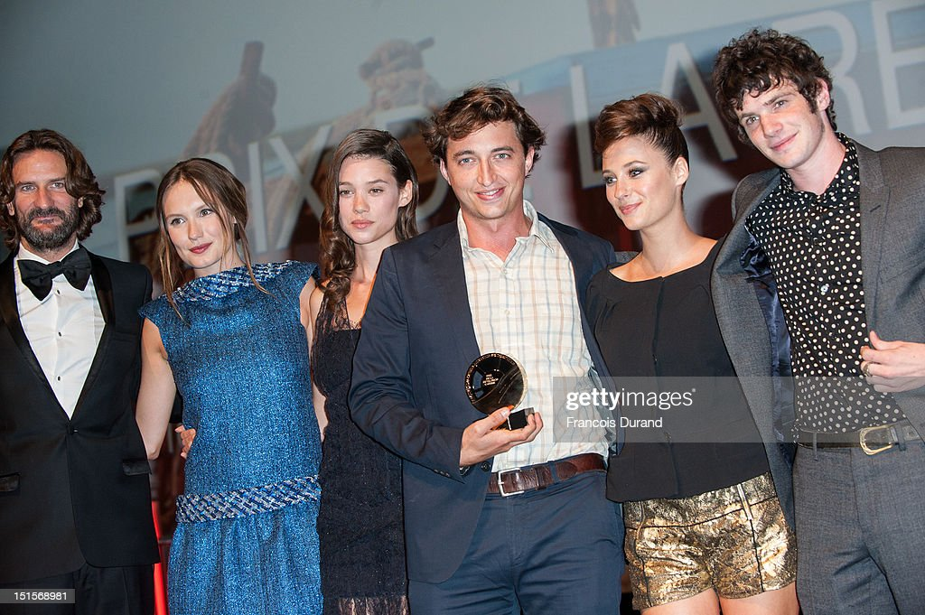Director Benh Zeitlin (C) poses with the jury 'Revelation Cartier' after the closing ceremony of the 38th Deauville American Film Festival on September 8, 2012 in Deauville, France.