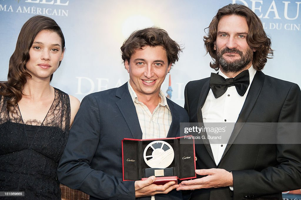 Director <a gi-track='captionPersonalityLinkClicked' href=/galleries/search?phrase=Benh+Zeitlin&family=editorial&specificpeople=6711208 ng-click='$event.stopPropagation()'>Benh Zeitlin</a> (C) poses with the jury 'Revelation Cartier' after the closing ceremony of the 38th Deauville American Film Festival on September 8, 2012 in Deauville, France.
