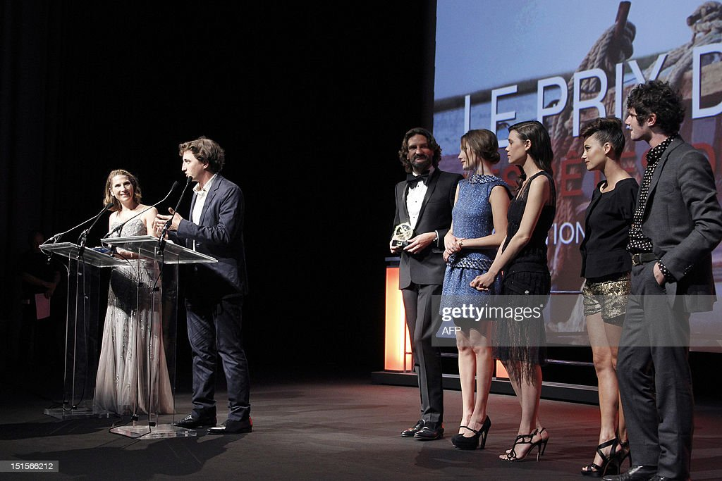 US director Benh Zeitlin (2ndL) thanks the audience during the awarding ceremony after receiving 'The Grand Prix' and the 'Prix de la Revelation Cartier' for his film 'Beasts of the Southern Wild' at the 38th Deauville's US Film Festival, on September 8, 2012 in the French northwestern sea resort of Deauville. From left, President of the Jury 'Revelation' and French writer Frederic Beigbeder (3rd), French actress Ana Girardot (4th), French-Spanish actress Astrid Berges-Frisbey (5th), French actress Melanie Bernier (6th) and French actor Felix Moati (R).