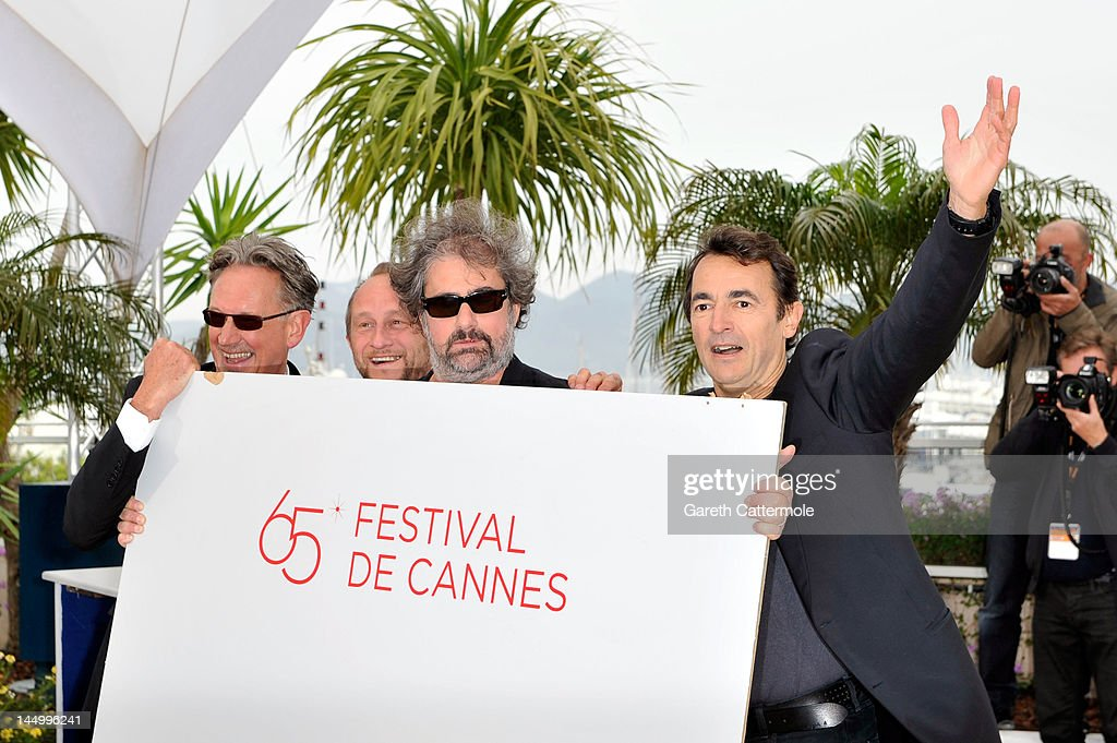 Director Benoit Delepine, actors Benoit Poelvoorde, Gustave Kervern and <a gi-track='captionPersonalityLinkClicked' href=/galleries/search?phrase=Albert+Dupontel&family=editorial&specificpeople=3096344 ng-click='$event.stopPropagation()'>Albert Dupontel</a> pose at the 'Le Grand Soir' photocall during the 65th Annual Cannes Film Festival at Palais des Festivals on May 22, 2012 in Cannes, France.