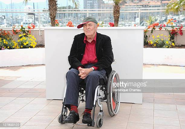 Director Bernardo Bertolucci attends a photocall at the Palais des Festivals during the 64th Cannes Film Festival on May 11 2011 in Cannes France