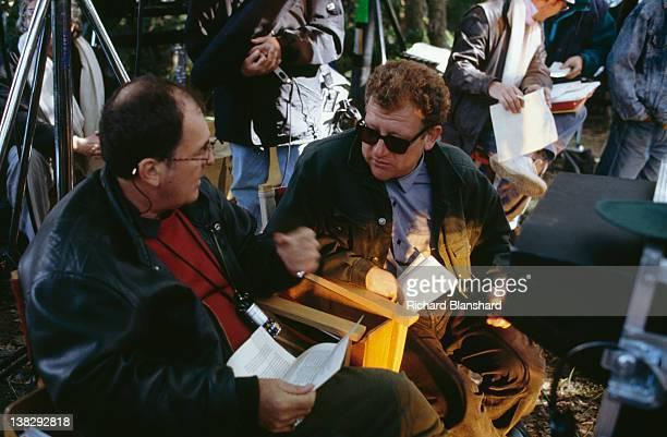 Director Bernardo Bertolucci with producer Jeremy Thomas on the set of the film 'Little Buddha' circa 1992