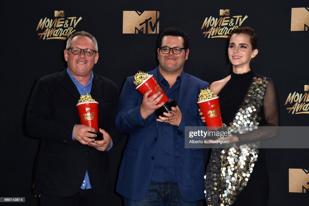 Director Bill Condon and actors Josh Gad and Emma Watson, winners of Movie of the Year for 'Beauty and the Beast', pose in the press room during the 2017 MTV Movie And TV Awards at The Shrine Auditorium on May 7, 2017 in Los Angeles, California.