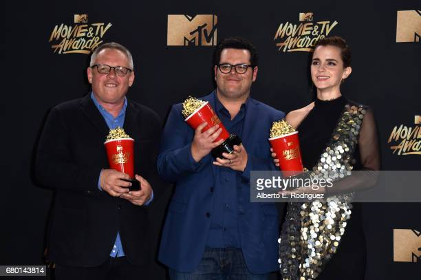 Director Bill Condon and actors Josh Gad and Emma Watson winners of Movie of the Year for 'Beauty and the Beast' pose in the press room during the...