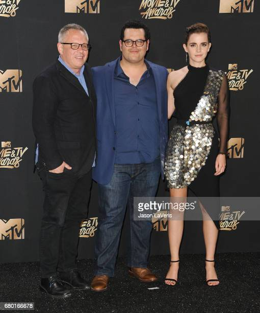 Director Bill Condon and actors Josh Gad and Emma Watson winners of Movie of the Year for 'Beauty and the Beast' pose in the press room at the 2017...