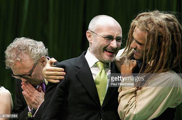 Director Bob Crowley songwriter Phil Collins and actor Josh Strickland appear onstage during opening night curtain call of 'Tarzan' at Richards...