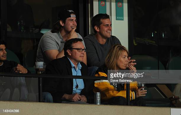 Director Bobby Farrelly and New England Patriots player Stephen Gostkowski watch the game of the Boston Bruins against the Washington Capitals in...