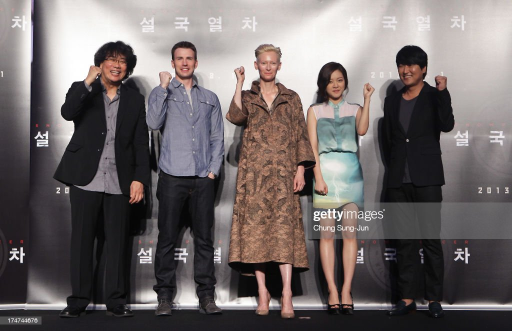 Director Bong Joon-Ho, actor <a gi-track='captionPersonalityLinkClicked' href=/galleries/search?phrase=Chris+Evans+-+Actor&family=editorial&specificpeople=6873149 ng-click='$event.stopPropagation()'>Chris Evans</a>, actress <a gi-track='captionPersonalityLinkClicked' href=/galleries/search?phrase=Tilda+Swinton&family=editorial&specificpeople=202991 ng-click='$event.stopPropagation()'>Tilda Swinton</a>, Ko A-Sung and actor Song Kang-Ho the 'Snowpiercer' press conference at Conrad Hotel on July 29, 2013 in Seoul, South Korea. The film will open in South Korea on August 1.