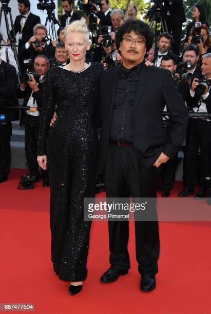 Director Bong JoonHo and actress Tilda Swinton attend the 70th Anniversary screening during the 70th annual Cannes Film Festival at Palais des...