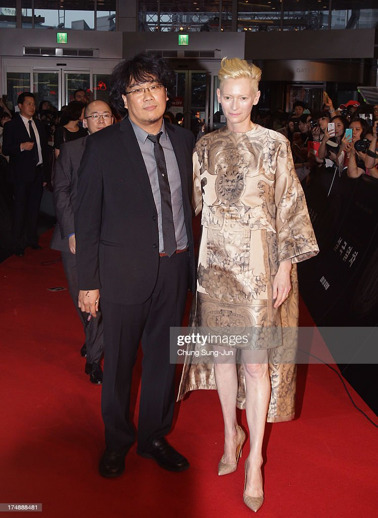 Director Bong Joon-Ho and actress <a gi-track='captionPersonalityLinkClicked' href=/galleries/search?phrase=Tilda+Swinton&family=editorial&specificpeople=202991 ng-click='$event.stopPropagation()'>Tilda Swinton</a> attend the 'Snowpiercer' South Korea premiere at Times Square on July 29, 2013 in Seoul, South Korea. The film will open in South Korea on August 1.