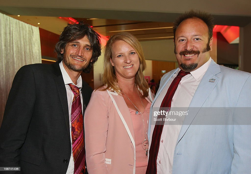 Director Boyd Hicklin, Kylea Tink, McGrath Foundation CEO and Nick Batzias pose during the 'High Tea at the G' luncheon on day two of the International Test match between Australia and Sri Lanka at Melbourne Cricket Ground on December 27, 2012 in Melbourne, Australia.