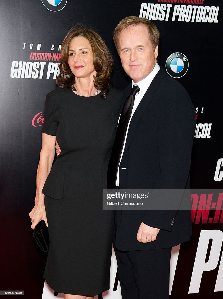 Director Brad Bird (R) and wife Elizabeth Canney attend the 'Mission: Impossible - Ghost Protocol' U.S. premiere at the Ziegfeld Theatre on December 19, 2011 in New York City.