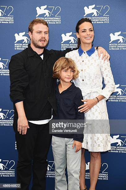 Director Brady Corbet actors Tom Sweet and Berenice Bejo attend a photocall for 'The Childhood Of A Leader' during the 72nd Venice Film Festival at...
