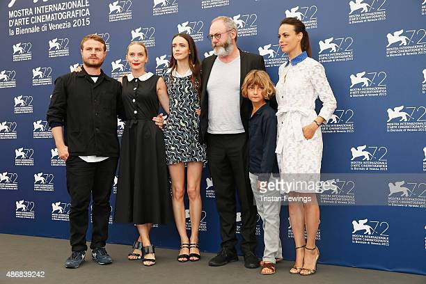 Director Brady Corbet cowriter Mona Fastvold actors Stacy Martin Liam Cunningham Tom Sweet and Berenice Bejo attend a photocall for 'The Childhood Of...