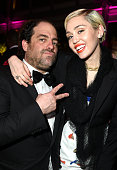 Director Brett Ratner and recording artist Miley Cyrus attend the 2015 Vanity Fair Oscar Party hosted by Graydon Carter at the Wallis Annenberg...