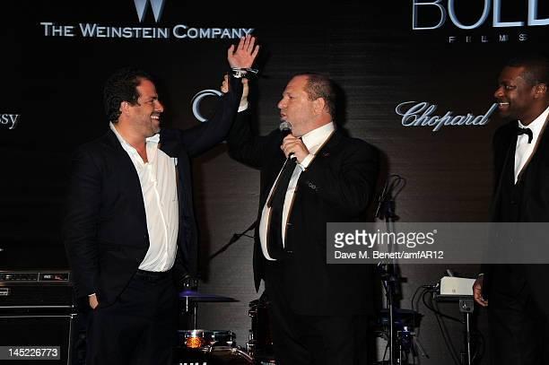 Director Brett Ratner chairman of The Weinstein Company Harvey Weinstein and actor Chris Tucker attend the 2012 amfAR's Cinema Against AIDS during...