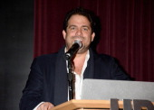 Director Brett Ratner speaks onstage at the 'Seduced And Abandoned' LA screening at Clarity Theater on October 22 2013 in Beverly Hills California