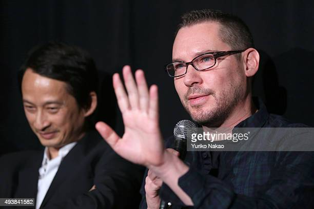 Director Brian Singer speaks next to director Tran Anh Hung during the Jury Press Conference during the Tokyo International Film Festival 2015 at...