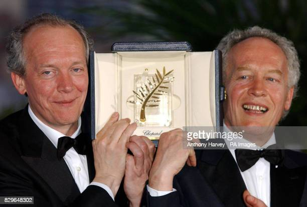 Director Brothers Luc and JeanPierre Dardenne celebrate winning the Palme d'Or wih 'L'enfant'