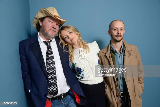 Director Bruce McDonald actress Sarah Allen and actor Maxwell McCabeLokos of 'The Husband' pose at the Guess Portrait Studio during 2013 Toronto...