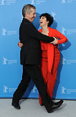 Director Bruno Dumont and actress Juliette Binoche dance together as they attend the 'Camille Claudel 1915' Photocall during the 63rd Berlinale...