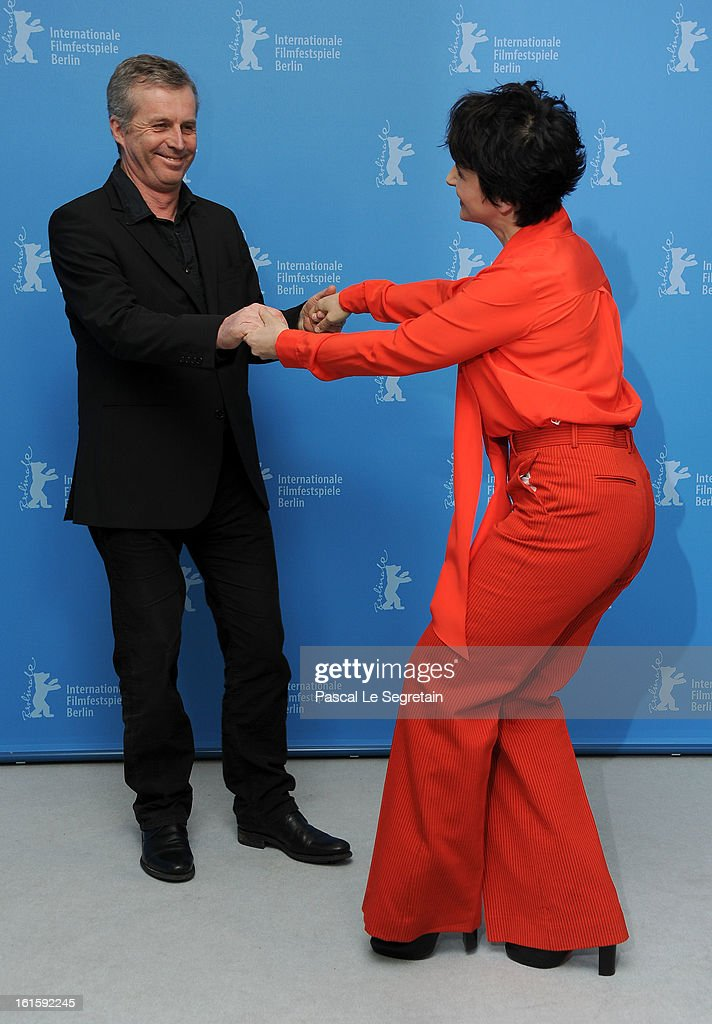 Director <a gi-track='captionPersonalityLinkClicked' href=/galleries/search?phrase=Bruno+Dumont&family=editorial&specificpeople=607004 ng-click='$event.stopPropagation()'>Bruno Dumont</a> and actress <a gi-track='captionPersonalityLinkClicked' href=/galleries/search?phrase=Juliette+Binoche&family=editorial&specificpeople=209273 ng-click='$event.stopPropagation()'>Juliette Binoche</a> dance together as they attend the 'Camille Claudel 1915' Photocall during the 63rd Berlinale International Film Festival at the Grand Hyatt Hotel on February 12, 2013 in Berlin, Germany.