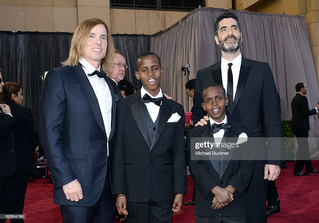 Director Bryan Buckley (L) and producer Mino Jarjoura (R) stand with cast member Harun Mohamed and Ali Mohamed at the Oscars at Hollywood & Highland Center on February 24, 2013 in Hollywood, California.