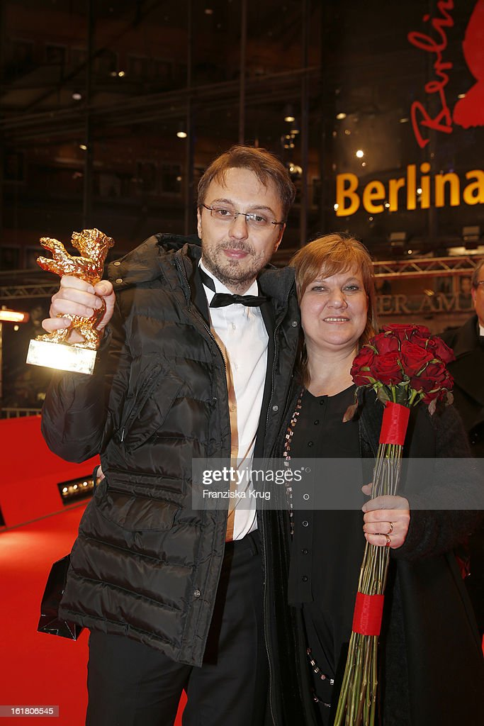 director Calin Peter Netzer (winner of Golden Bear for the best film) and Ada Solomon attend the Closing Ceremony Red Carpet Arrivals - BMW At The 63rd Berlinale International Film Festival at Berlinale-Palast on February 16, 2013 in Berlin, Germany.