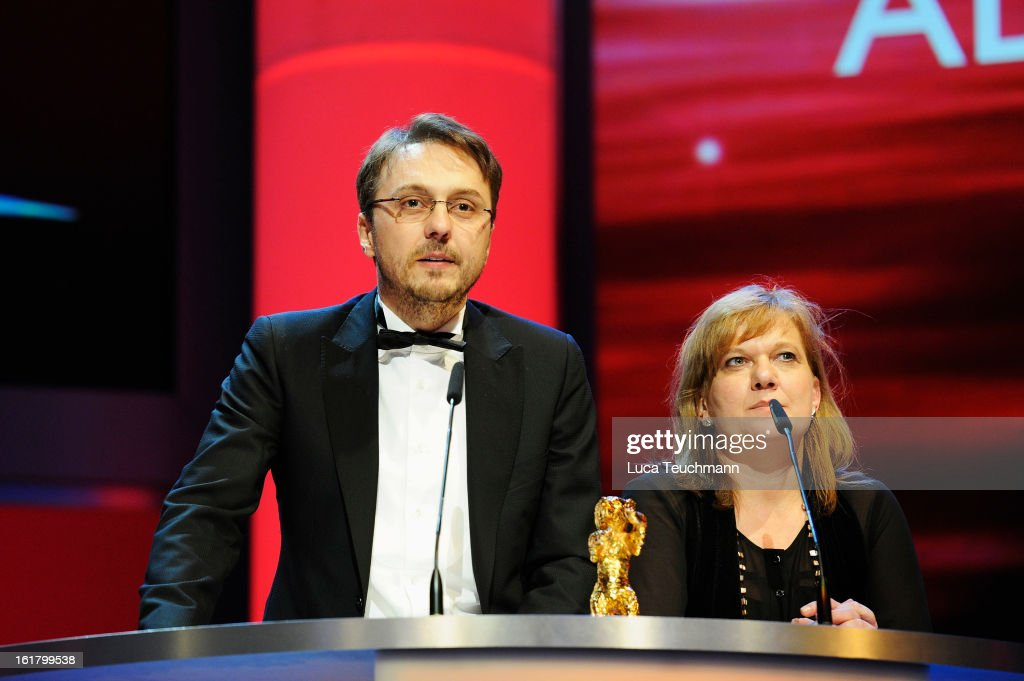 Director Calin Peter Netzer (L) receives the golden bear at the Closing Ceremony during the 63rd Berlinale International Film Festival at Berlinale Palast on February 14, 2013 in Berlin, Germany.