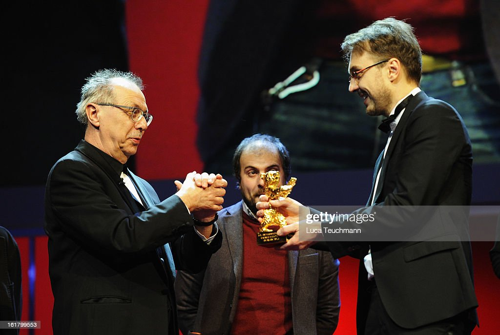 Director Calin Peter Netzer (R) receives the golden bear by <a gi-track='captionPersonalityLinkClicked' href=/galleries/search?phrase=Dieter+Kosslick&family=editorial&specificpeople=213030 ng-click='$event.stopPropagation()'>Dieter Kosslick</a> (L) at the Closing Ceremony during the 63rd Berlinale International Film Festival at Berlinale Palast on February 14, 2013 in Berlin, Germany.