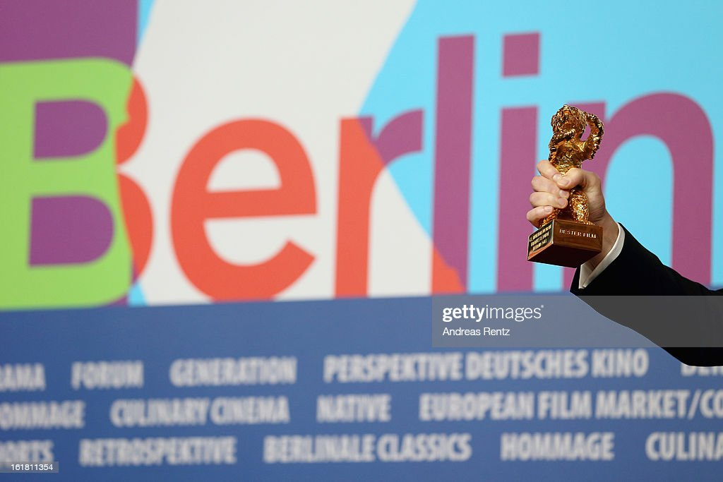 Director Calin Peter Netzer ( hand detail) with the Golden Bear at the Award Winners press conference during the 63rd Berlinale International Film Festival at Grand Hyatt Hotel on February 14, 2013 in Berlin, Germany.