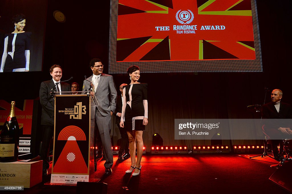 Director Caradog W. James (L) and actress Pooneh Hajimohammadi receive The Raindance Award as they attend the ceremony for the Moet British Independent Film Awards at Old Billingsgate Market on December 8, 2013 in London, England.
