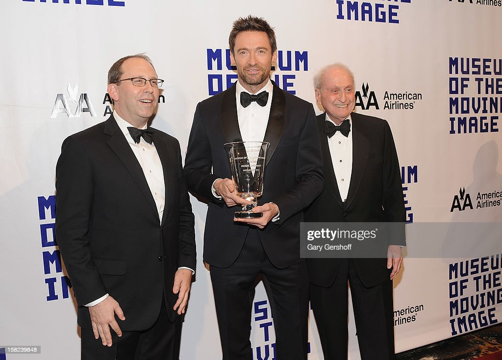 MMI Director Carl Goodman, event honoree <a gi-track='captionPersonalityLinkClicked' href=/galleries/search?phrase=Hugh+Jackman&family=editorial&specificpeople=202499 ng-click='$event.stopPropagation()'>Hugh Jackman</a> and MMI Board Chairman television executive Herb S. Schlosser attend the Museum Of Moving Image Salute To <a gi-track='captionPersonalityLinkClicked' href=/galleries/search?phrase=Hugh+Jackman&family=editorial&specificpeople=202499 ng-click='$event.stopPropagation()'>Hugh Jackman</a> at Cipriani Wall Street on December 11, 2012 in New York City.