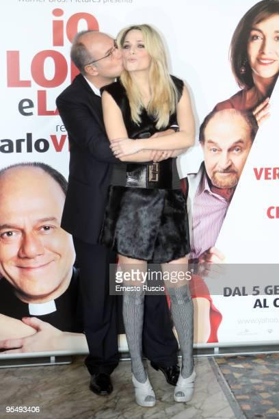 Director Carlo Verdone and actress Laura Chiatti attend the 'Io E Lara' photocall at Warner Moderno on December 30 2009 in Rome Italy