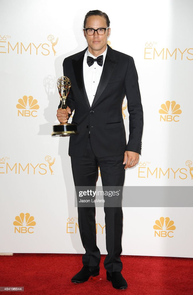 Director <a gi-track='captionPersonalityLinkClicked' href=/galleries/search?phrase=Cary+Fukunaga+-+Film+Director&family=editorial&specificpeople=2350874 ng-click='$event.stopPropagation()'>Cary Fukunaga</a> poses in the press room at the 66th annual Primetime Emmy Awards at Nokia Theatre L.A. Live on August 25, 2014 in Los Angeles, California.