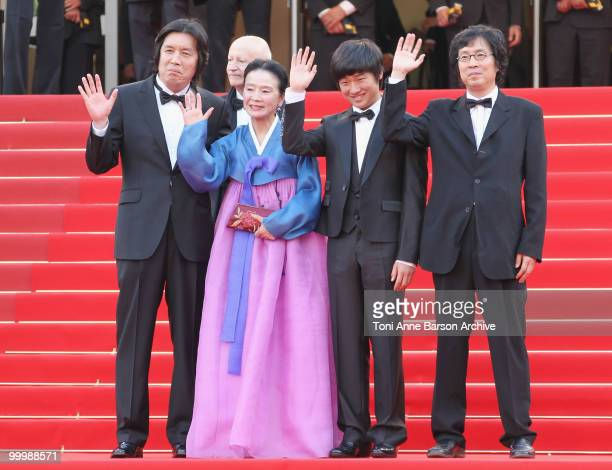 Director ChangDong Lee actress Jeonghee Yoon actor David Lee and Producer Jundong Lee attend the premiere of 'Poetry' held at the Palais des...
