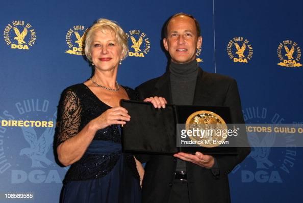 Director Charles Ferguson winner of the Documentary DGA Award for 'Inside Job' poses in the press room with presenter Dame Helen Mirren at the 63rd...