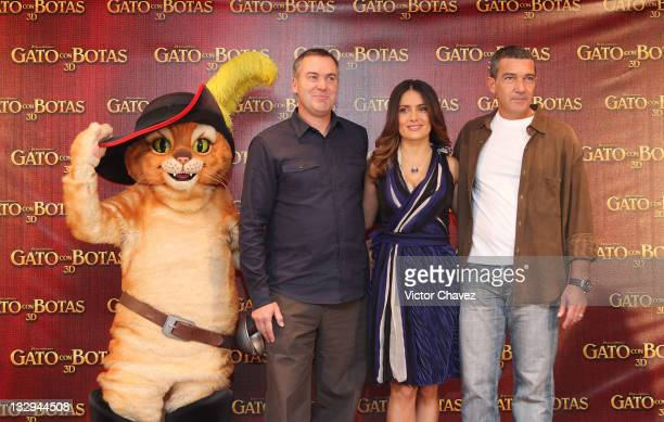 director Chris Miller actress Salma Hayek and actor Antonio Banderas attend a photocall for 'Puss In Boots' at the Four Seasons Hotel on November 15...