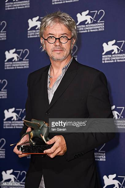 Director Christian Vincent poses with the Best Screenplay Award for the movie 'L'Hermine' as he attends the award winners photocall during the 72nd...