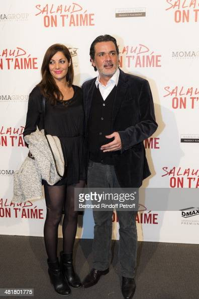 Director Christophe Barratier and his companion actress Gwendoline Doycheva pose during the premiere of 'Salaud on t'aime' directed by French...