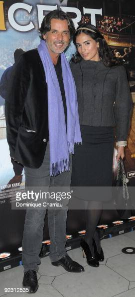 Director Christophe barratier and his girlfriend Attend the premiere of ''Le Concert'' at the Theatre du Chatelet on October 23 2009 in Paris France