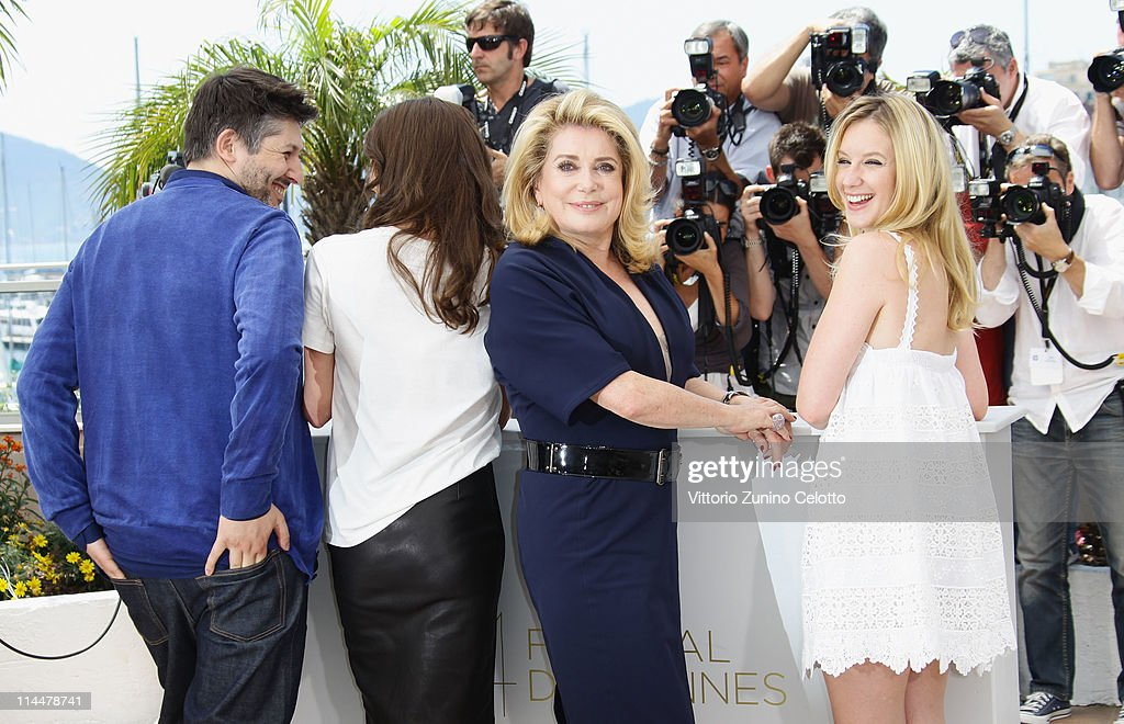Director Christophe Honore with actresses Chiara Mastroianni Catherine Deneuve and Laudivine Sagnier attend the 'Les BienAimes' Photocall at Palais...