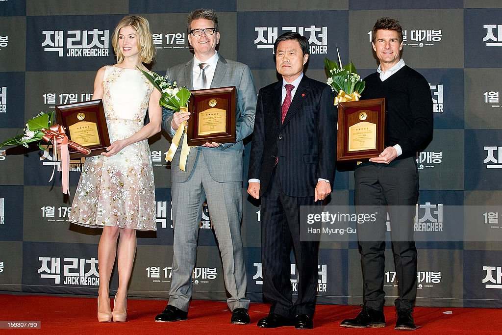 Director Christopher McQuarrie and actors <a gi-track='captionPersonalityLinkClicked' href=/galleries/search?phrase=Tom+Cruise&family=editorial&specificpeople=156405 ng-click='$event.stopPropagation()'>Tom Cruise</a> and <a gi-track='captionPersonalityLinkClicked' href=/galleries/search?phrase=Rosamund+Pike&family=editorial&specificpeople=208910 ng-click='$event.stopPropagation()'>Rosamund Pike</a> pose for media after receive an certificate honorary citizenship of the Busan City by Busan City mayor, Huh Nam-Shik during the 'Jack Reacher' Fan Screening at Busan Cinema Center on January 10, 2013 in Busan, South Korea. The film will open on January 17 in South Korea.