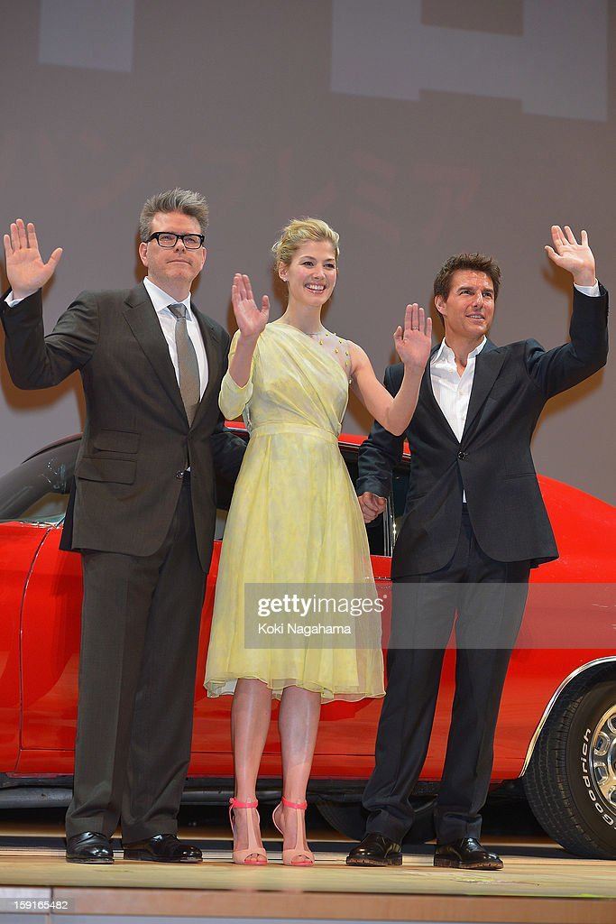 Director Christopher McQuarrie and Actress <a gi-track='captionPersonalityLinkClicked' href=/galleries/search?phrase=Rosamund+Pike&family=editorial&specificpeople=208910 ng-click='$event.stopPropagation()'>Rosamund Pike</a> and Actor <a gi-track='captionPersonalityLinkClicked' href=/galleries/search?phrase=Tom+Cruise&family=editorial&specificpeople=156405 ng-click='$event.stopPropagation()'>Tom Cruise</a> wave their hands during the 'Jack Reacher' Japan Premiere at Tokyo International Forum on January 9, 2013 in Tokyo, Japan.