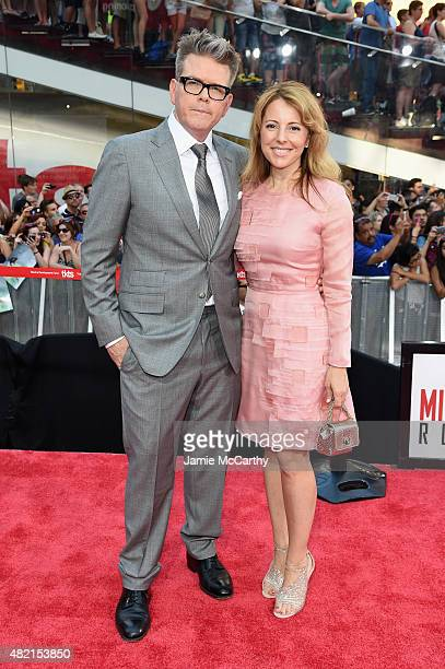 Director Christopher McQuarrie and Heather McQuarrie attend the 'Mission Impossible Rogue Nation' New York premiere at Duffy Square in Times Square...