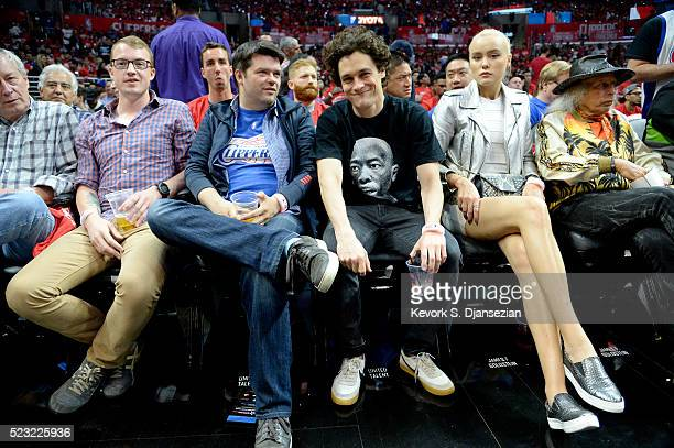 Director Christopher Miller director Phil Lord model Ilona Guzarevich and James Goldstein watch the Los Angeles Lakers vs the Portland Trail Blazers...