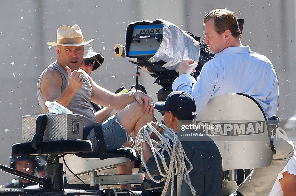 Director <a gi-track='captionPersonalityLinkClicked' href=/galleries/search?phrase=Christopher+Nolan&family=editorial&specificpeople=235975 ng-click='$event.stopPropagation()'>Christopher Nolan</a> (right) sits in a bucket crane in between scenes as fake snow falls during the filming of the new Batman: Dark Knight Rises movie at the Mellon Institute building in the Pittsburgh neighborhood of Oakland on July 31, 2011.